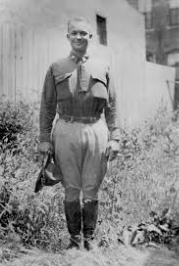 Lieutenant Colonel Dwight Eisenhower stands at attention in a grassy area