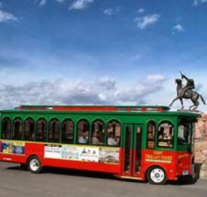 The Cody Trolley parks in front of a statue of Buffalo Bill