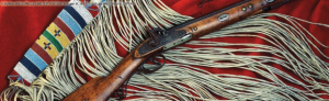 An S. Hawken Plains Rifle resting on a red blanket