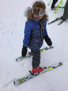 A young skier poses for the camera at Sleeping Giant Ski Area