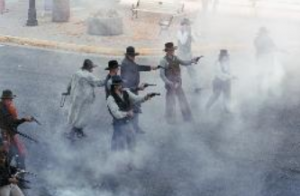 A gunfight reenactment takes place outside the Irma Hotel