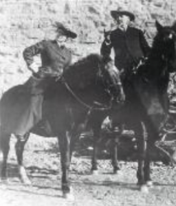 A vintage black and white photo of Caroline Lockhart and Buffalo Bill