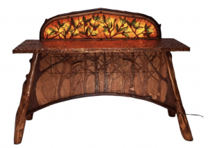 An ornately designed table with tree carvings
