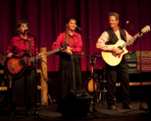 Dan Miller, Hannah Miller and Wendy Corr performing music for an audience