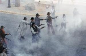 Actors reenact a gun fight